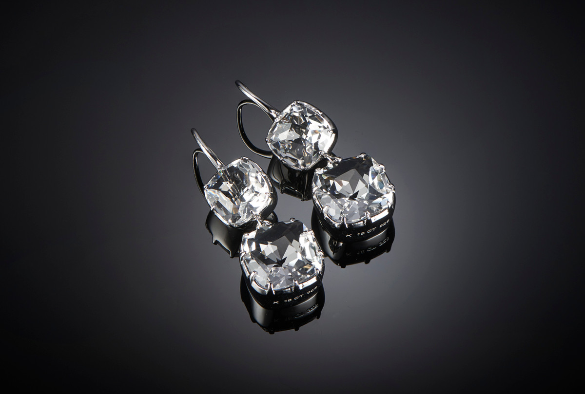 Kozminsky Large Double Drop Rock Crystal Earrings in Silver. Cushion cut rock crystal suspending a larger cushion cut drop. Hook fitting. Sterling Silver and Rhodium Plated.