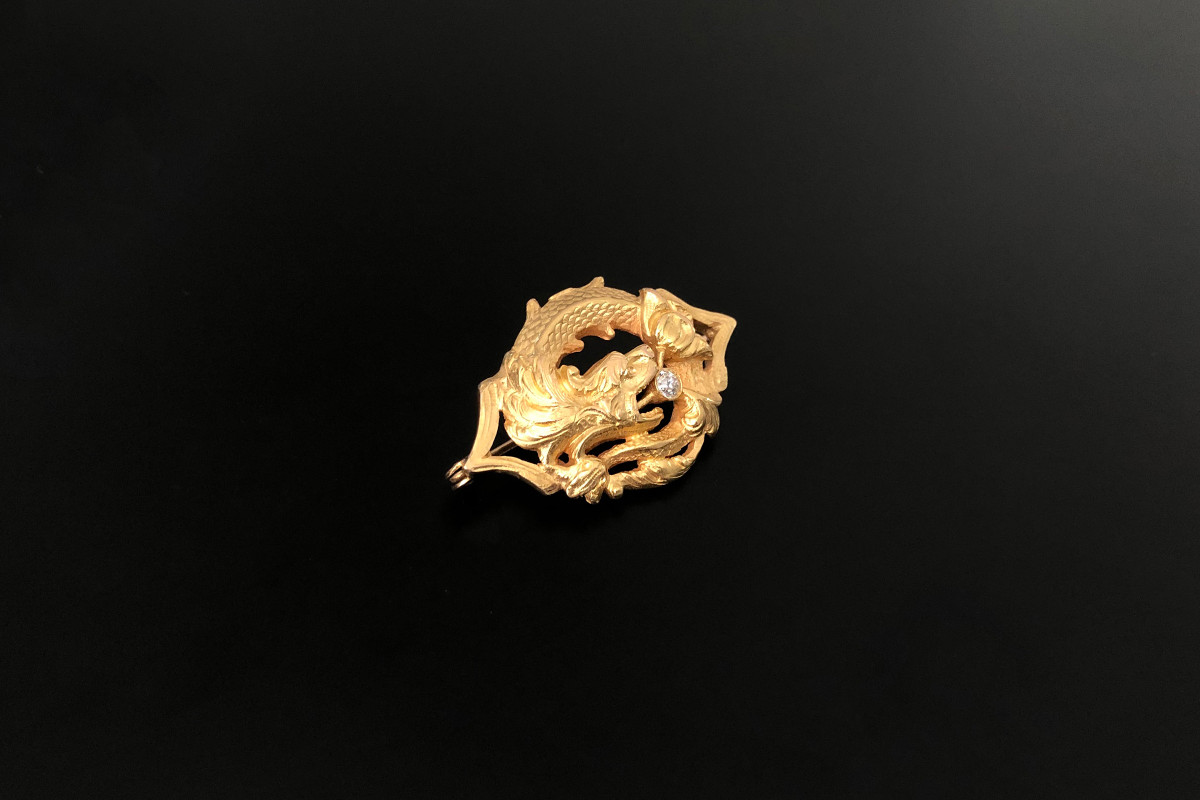 A striking Gold and Diamond Chimaera Brooch