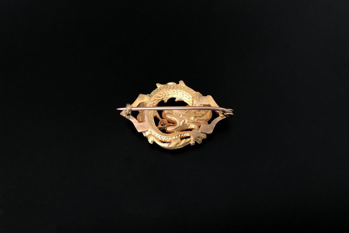 A striking Gold and Diamond Chimaera Brooch