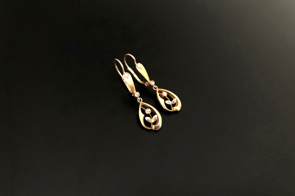 A Delicate Pair of Diamond and Gold Pendant Earrings