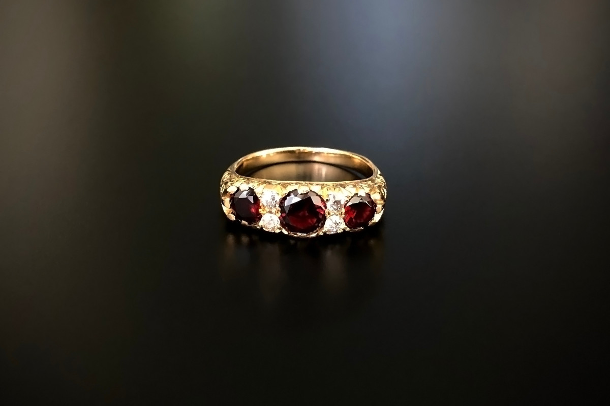 A Beautiful Garnet and Diamond Half Hoop Ring