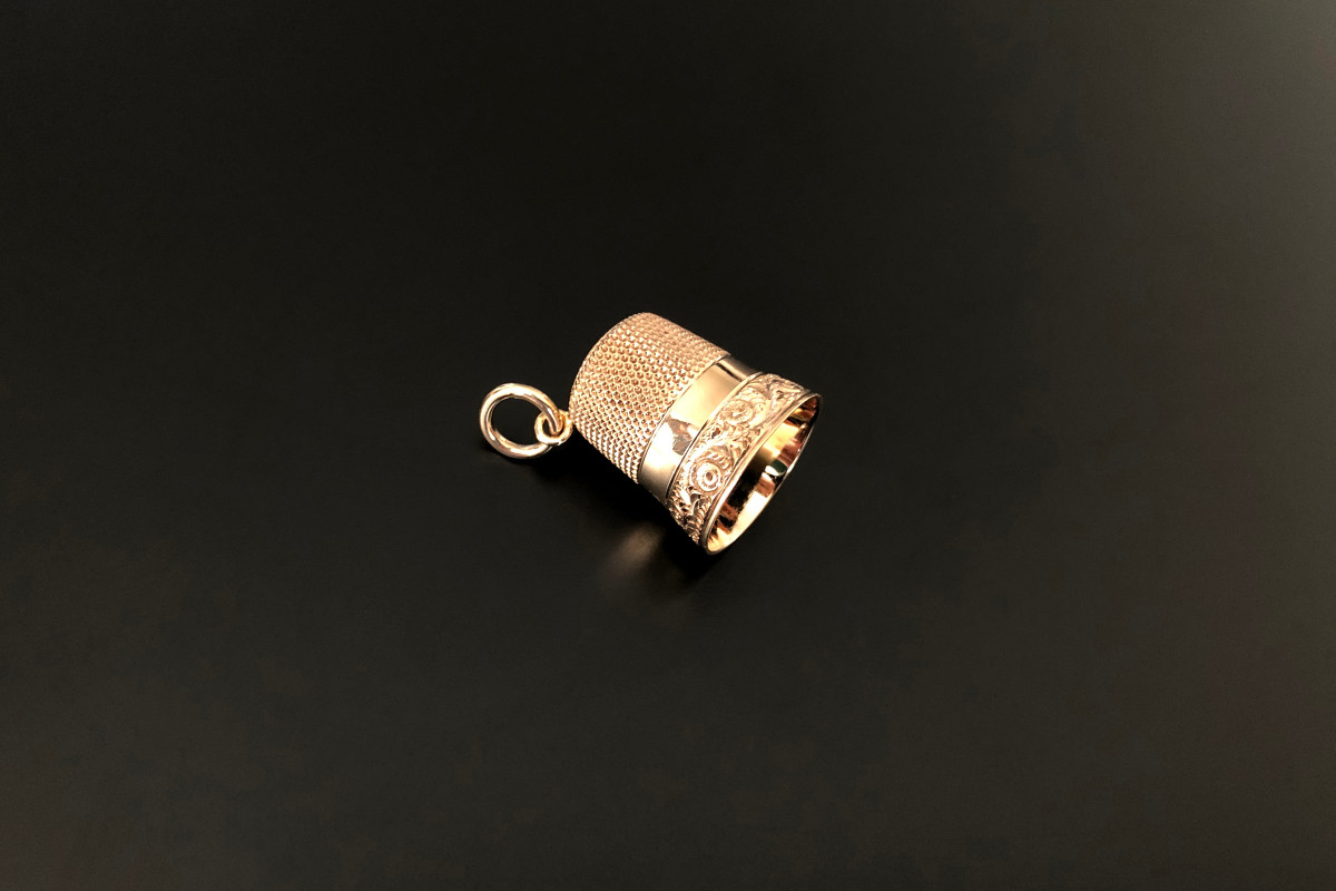 A Dainty Gold Thimble Pendant