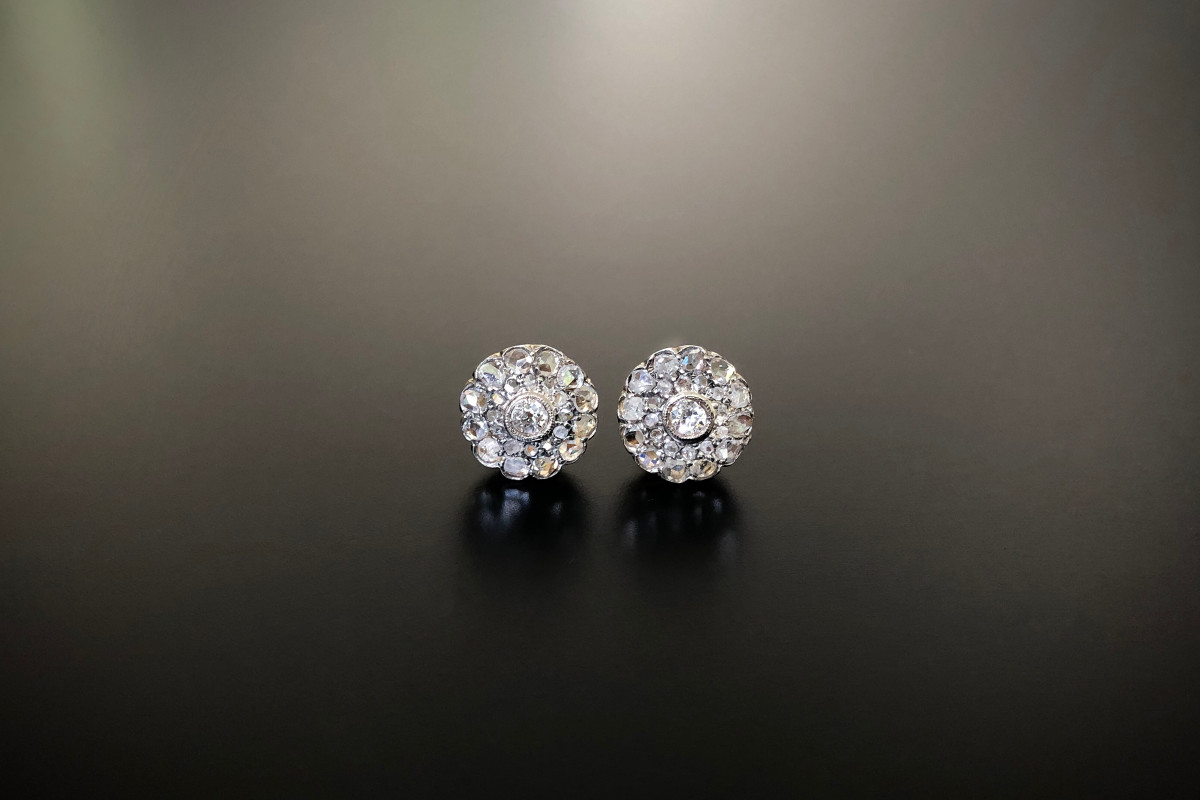 Rose Cut Diamond Cluster Earrings, Centrally set with an old European cut diamond,  surrounded by two rows of small rose cut diamonds  Total diamond weight: 0.90cts  Colour: H  Clarity: SI  Total weight: 2.90gms  18ct white and yellow gold  Antique