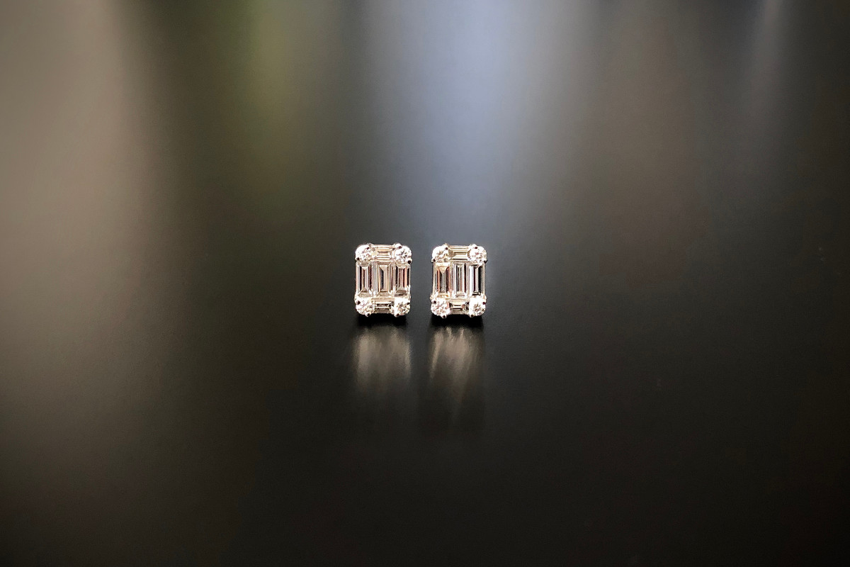 Diamond Cluster Stud Earrings Set with baguette and round brilliant cut diamonds. Total diamond weight: 1.04cts Colour G Clarity: SI 18ct white gold  Total weight 2.45gms