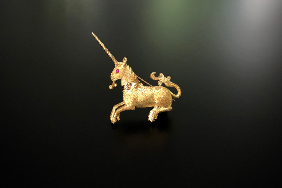 Gold unicorn brooch.
