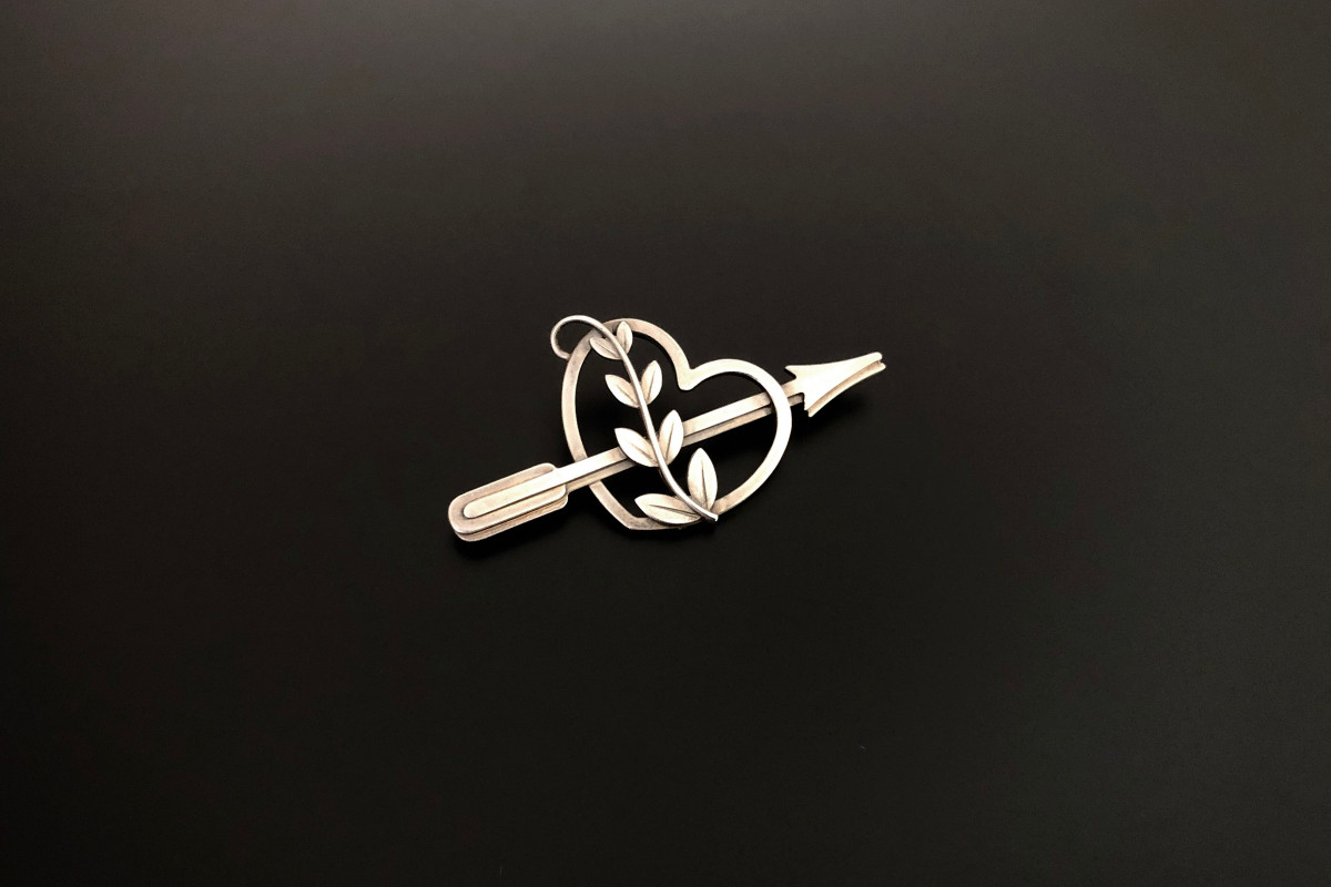 Sterling Silver Brooch by Georg Jensen Modelled as a pierced heart and arrow with vine leaves Sterling silver Reference 242A Total weight: 6gms Total length: 55mm