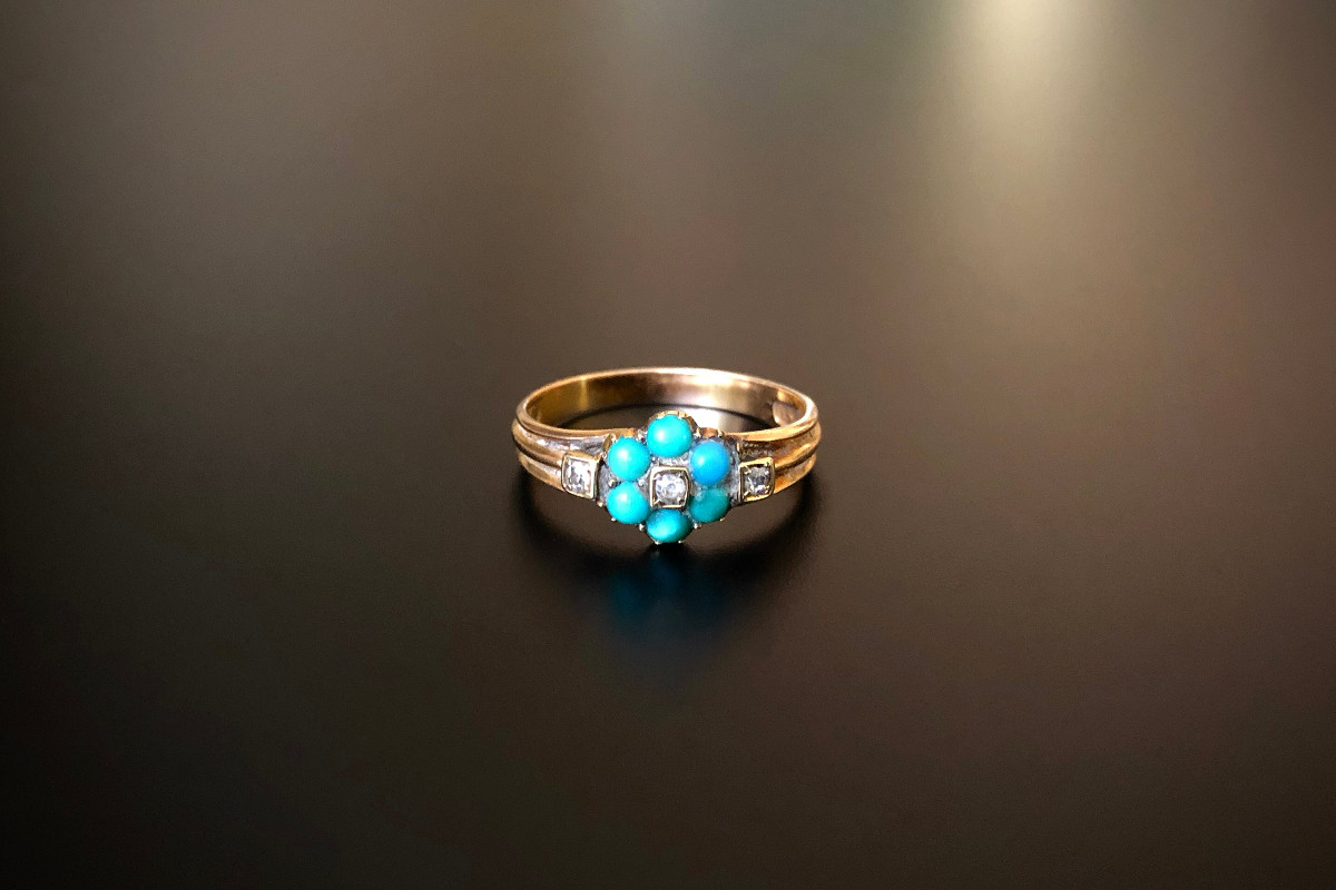 A Charming Forget Me Knot Ring Turquoise set petals highlighted with small single cut diamonds  Reeded band 15ct yellow gold Victorian  Circa 1880
