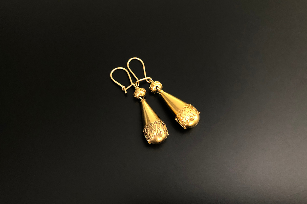 A Stunning Pair of Etruscan Revival Gold Earrings Fluted form overlaid with delicate wirework Surmounted by a small bead with conforming decoration Continental hook fittings 18ct gold Total weight: 5.35gms
