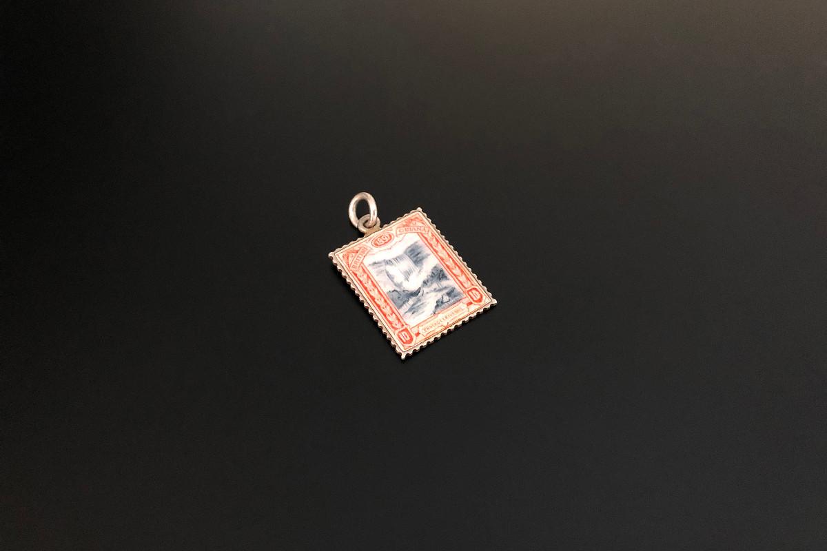 A Unique Red Enamel Stamp Pendant