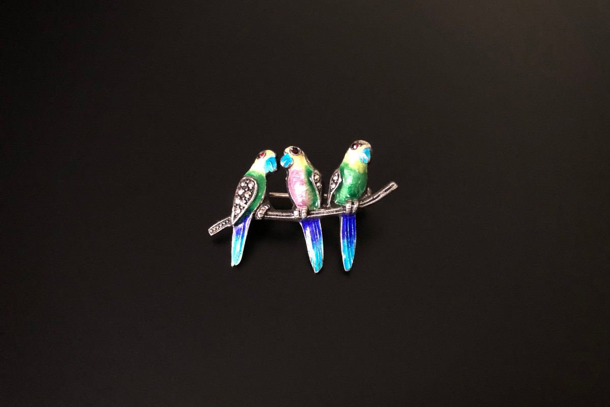 A Divine Silver, Enamel and Marcasite Brooch by Alice Caviness Modelled as three parrots on a branch Blue, green, yellow and purple enamel Red paste set eyes Sterling silver German Total weight: 5.65gm Total length: 35mm x 22mm
