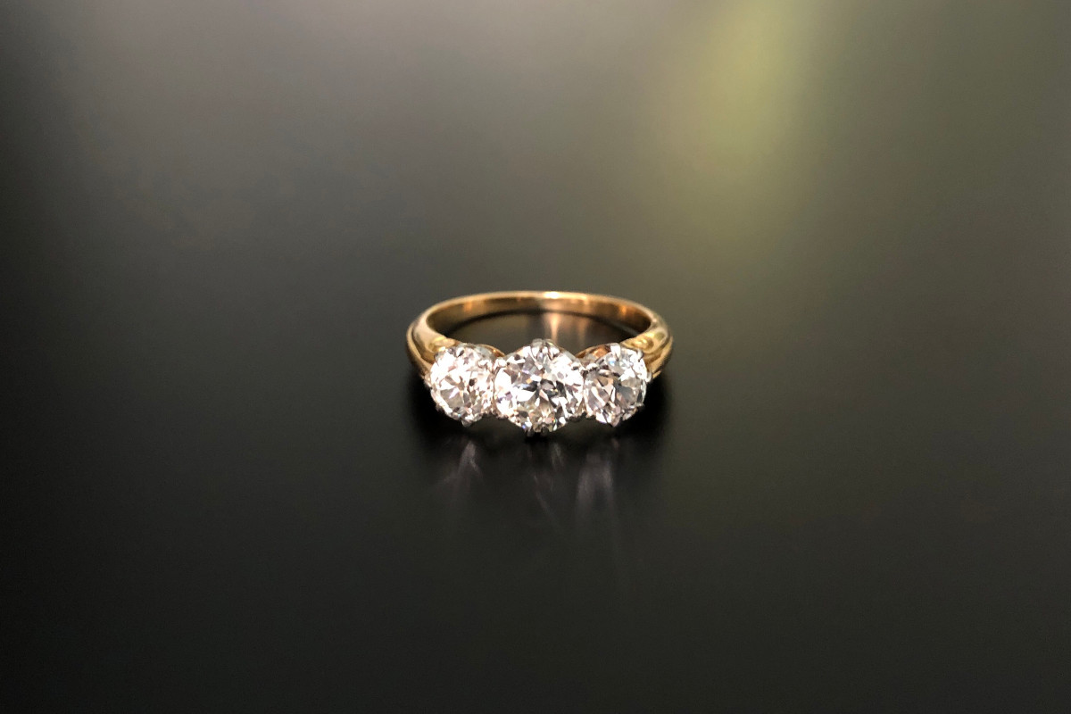 A Classic Three Stone Diamond Ring Comprising three old European cut diamonds  Individual claw set coronet mounts 18ct yellow and white gold Total diamond weight: 2.00cts Colour: G Clarity: VS-SI Total weight: 4.03gms