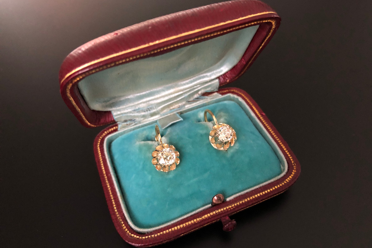 A Divine Pair of French Diamond Earrings Each set with a cushion shaped old European cut diamond  Claw set in a dahlia shaped floral frame 18ct yellow gold Continental hook fittings  Total diamond weight: 1.30cts Colour: L Clarity: SI Total weight: 1.80gms
