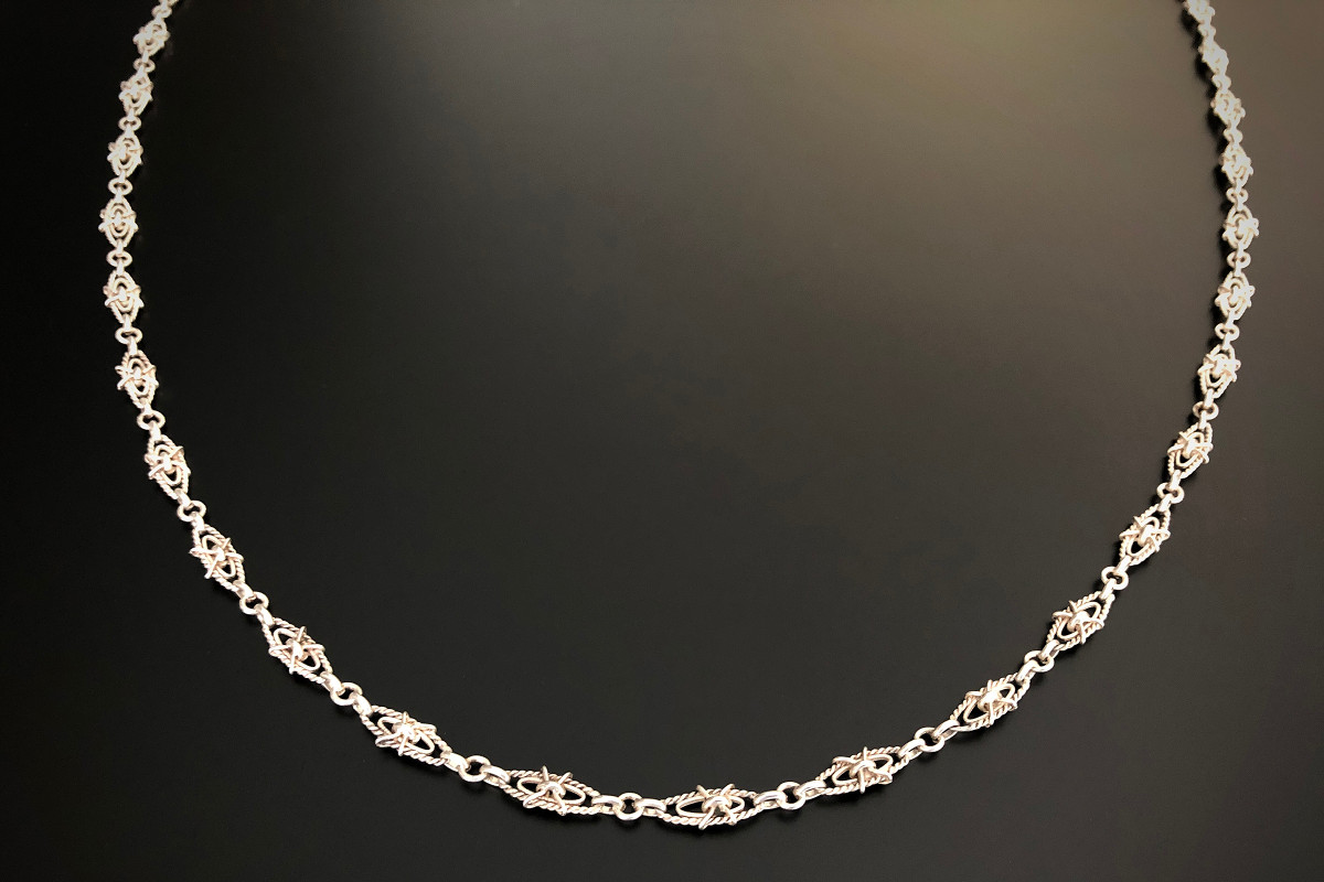 A Lovely Silver Guard Chain Pierced oval links with cross formation set to the centre Silver Total weight: 22.8gms Total length: 1360mm