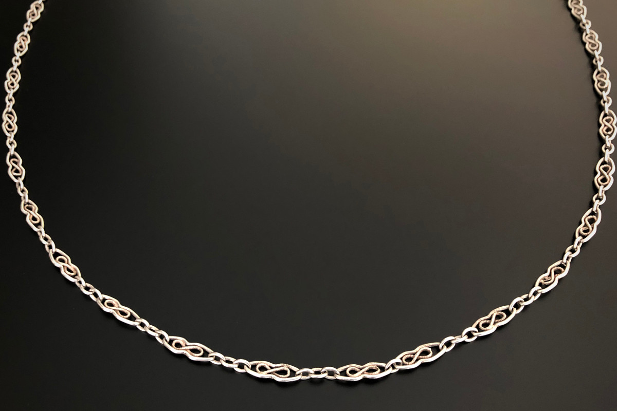 A Classic Silver Guard Chain Pierced oval links with figure eight motif Silver Total weight: 36.1gms Total length: 1460mm