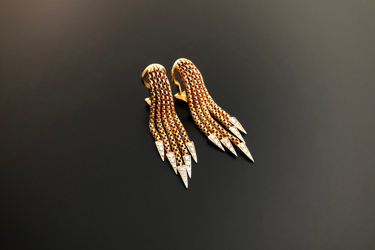 A Fabulous Pair of Italian Gold and Diamond Earrings Graduated fringe form Tips set with three graduated single cut diamonds 18ct yellow gold Clip fittings Total diamond weight: 0.40cts Colour: G-H Clarity: VS Total weight: 11.55gms Total length: 40mm Circa 1970