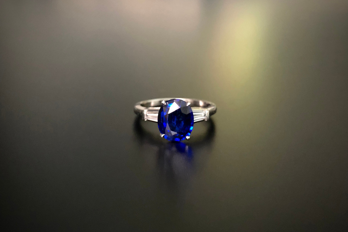 A Wonderful Sapphire and Diamond Ring The emerald cut sapphire flanked by two baguette cut diamonds Sapphire weight:  Diamond weight: 2.8 x 5.3 18ct white gold Total weight: 10gms