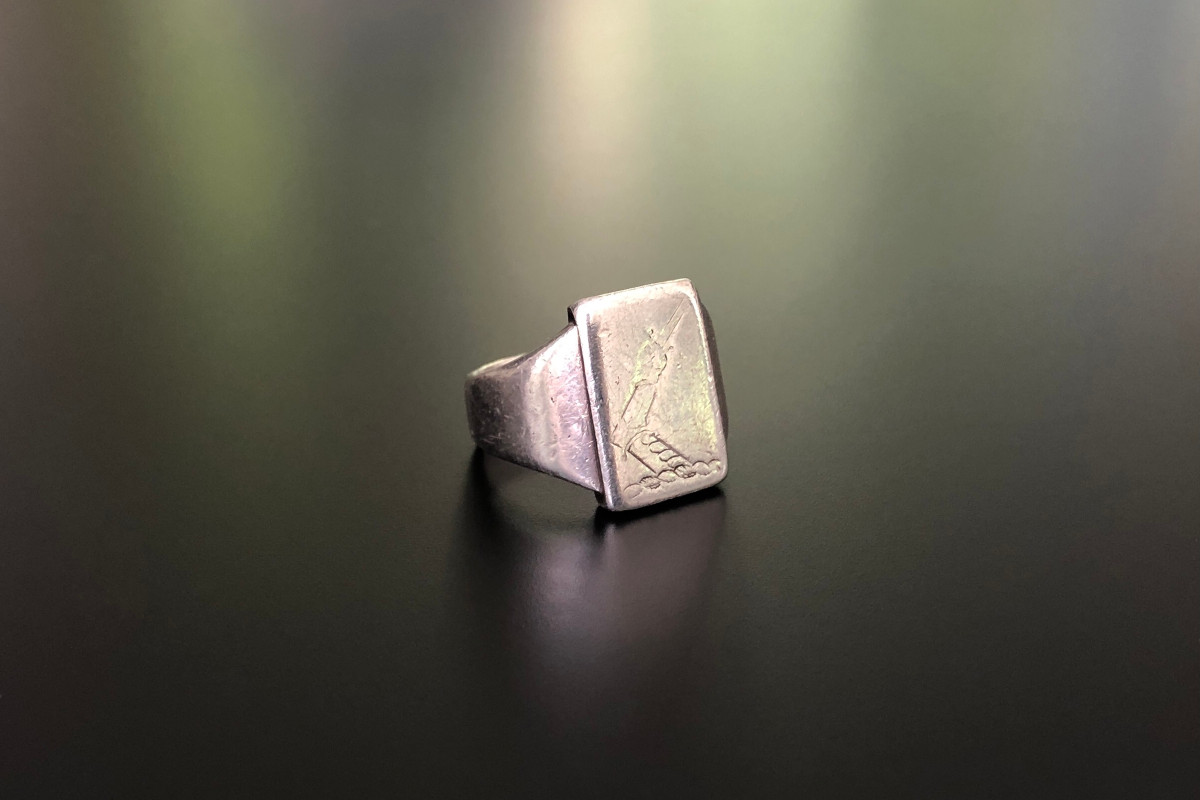 A Unique Sterling Silver Signet Ring by Georg Jensen Rectangular form Engraved motif of an arm holding a sword Sterling silver Reference 84 C Total weight: 13.3gms