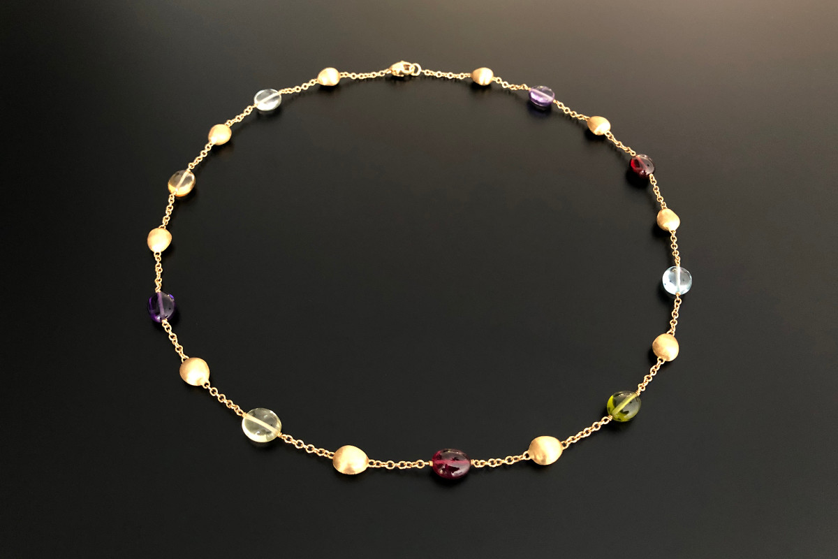 Necklace by Marco Bicego  Featuring polished free form semi precious stones including garnet, amethyst, peridot, citrine, quartz and interspaced with oval gold beads with bloomed finish Suspended on a fine trace chain Total weight: 12.3gms Total length: 440mm