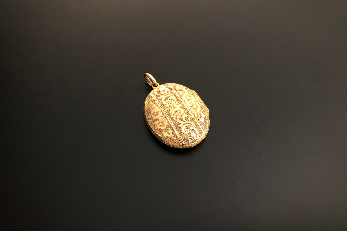 An Elegant Gold Locket Oval hinged form Engraved and chased scroll and foliate detail 15ct gold Total weight: 6.15gms Victorian Circa 1880