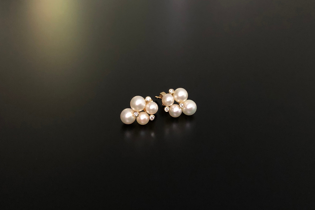 An Elegant Pair of Pearl and Diamond Earrings Quatrefoil form Featuring four cultured Akoya pearls measuring 4.5-6mm Interspaced by three small round brilliant cut diamonds 18ct yellow gold Post and butterfly back fittings Diamonds total 0.08cts Dimensions: 13 x 10mm