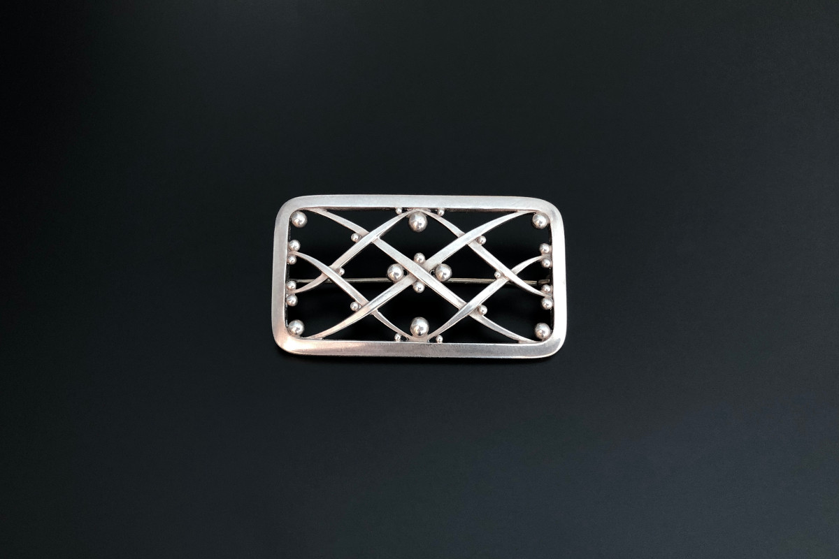 A Fabulous Rectangular Brooch by Georg Jensen Designed by Harald Nielsen Pierced form with criss cross pattern and applied bead decoration Reference 266 Sterling silver Total weight: 14.10gms Dimensions: 63 x 40mm