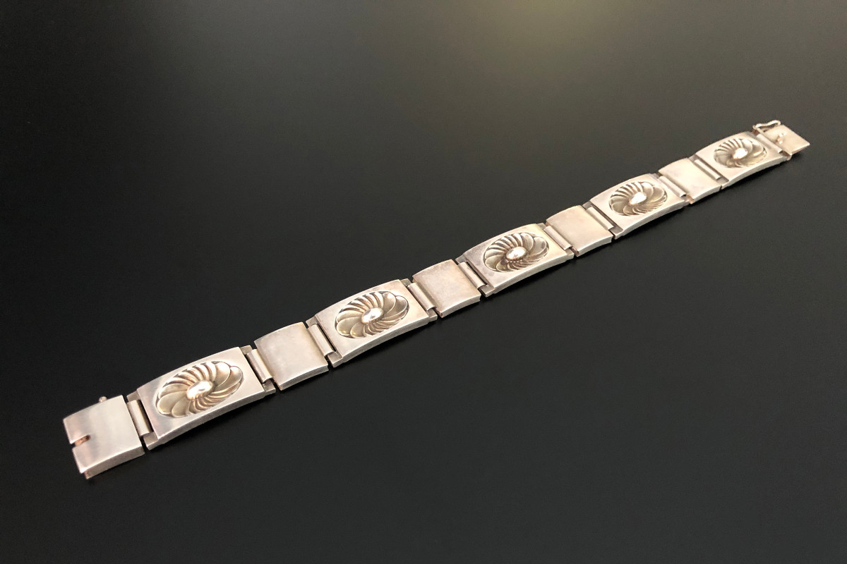 A Fabulous Sterling Silver Bracelet by Georg Jensen Designed by Henry Pilstrup Rectangular links, each inset with an alternating stylised flower motif Reference 56A Sterling silver Total weight: 44.45gms Total length: 190mm