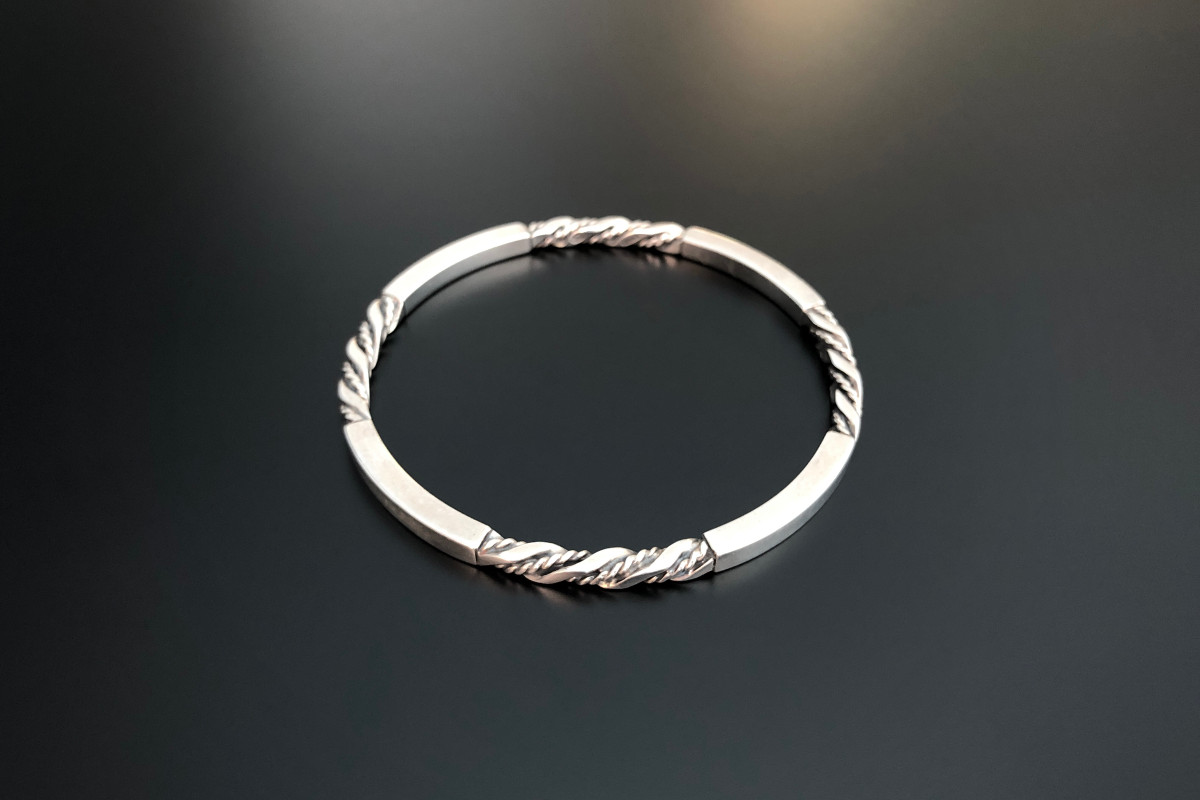 A Classic Sterling Silver Bangle by Georg Jensen Circular form Polished and mill finish design Reference 17C Sterling silver Total weight: 26.75gms 80mm diameter