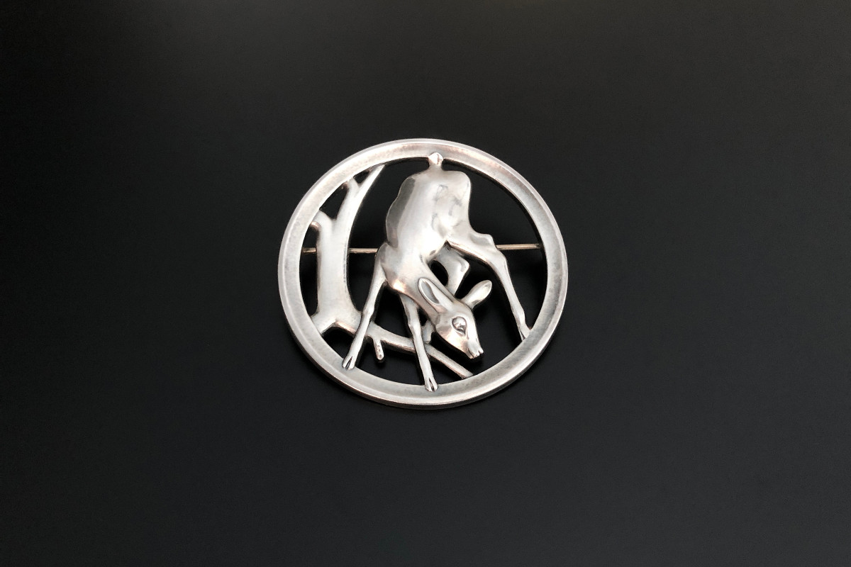 A Rare Sterling Silver Brooch by Georg Jensen Designed by Hugo Liisberg Circular pierced form Doe design Reference 298 Sterling silver Total weight: 20.8gms 65mm diameter