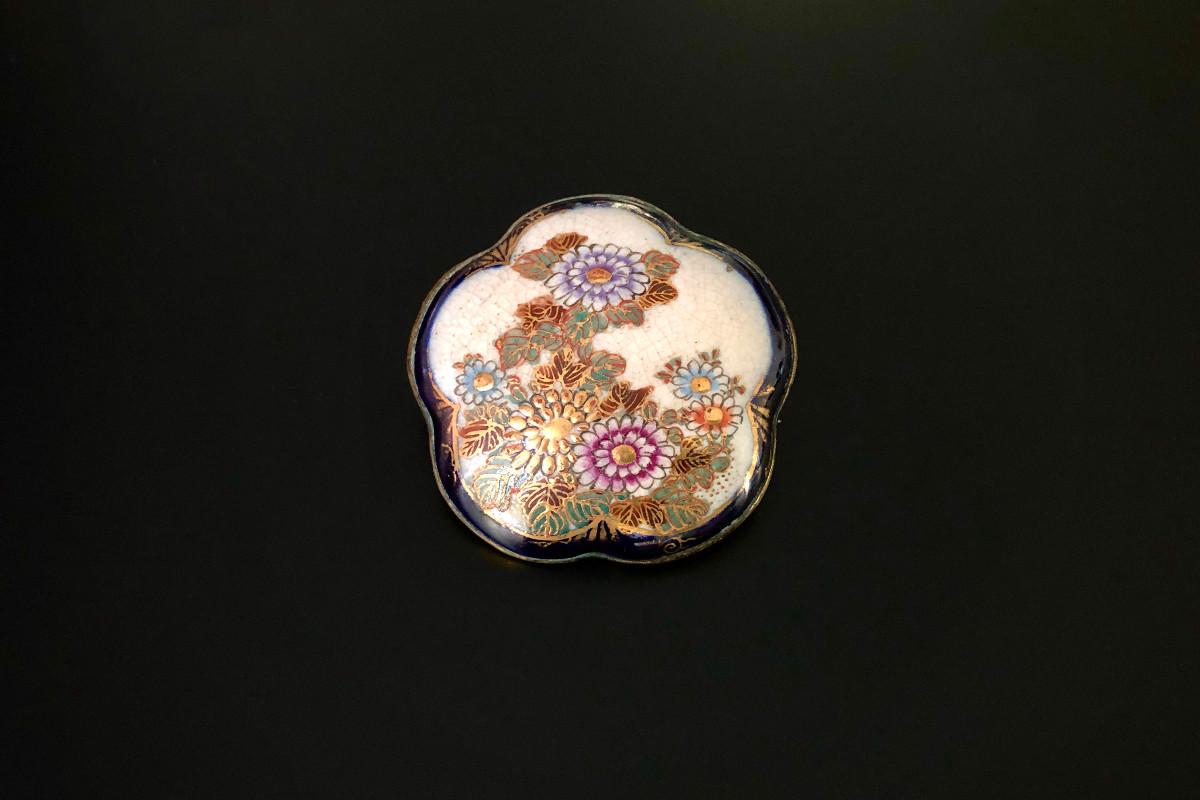 A Beautiful Satsuma Brooch Flower form Handpainted Depicting chrysanthemum and foliage Gilt decoration 47mm Meiji period