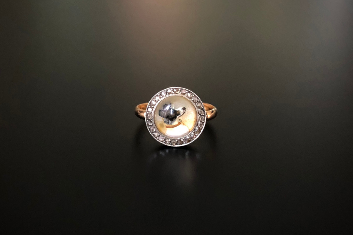 Reverse Crystal Intaglio and Diamond Ring Cabochon crystal with carved portrait of a dog surrounded by small Rose Cut diamonds in a fine millegrain frame. Platinum setting. 18ct rose gold band c1870. Size L