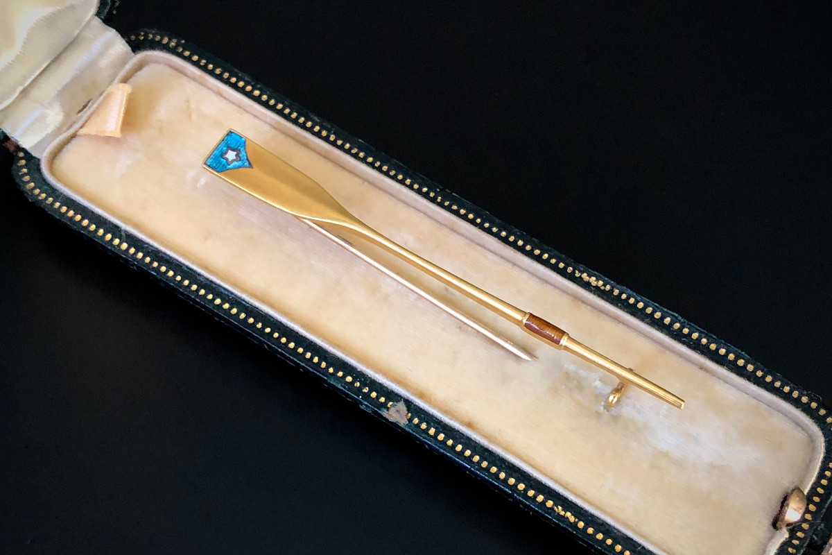 A Handsome Gold and Enamel Ore Brooch Turquoise and white star enamel detail to the blade Caramel enamel detail to the sleeve. 18ct yellow gold Total length: 60mm Hallmarked Antique