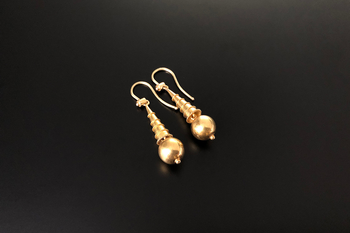 A  Delightful Pair of Etruscan Revival Gold Drop Earrings Conical form with fine rope twist decoration, Suspending a polished spherical ball, finished with a small bead. Shepherds hook fittings. 18ct yellow gold. Total weight: 2.92gms Total length: 36mm French. Circa 1900.
