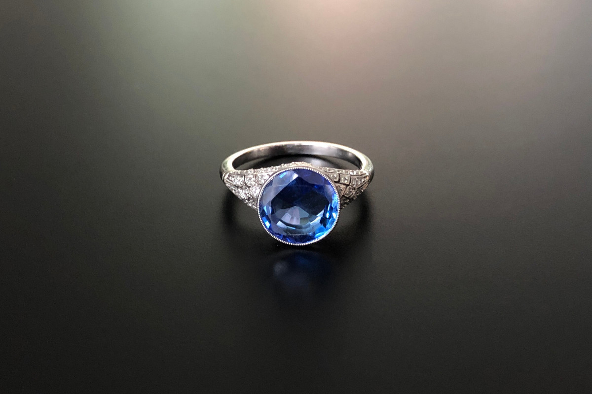 A Sublime Sapphire and Diamond Ring Round Ceylon Sapphire bezel set Surrounded by a fine pierced gallery, millegrain set with Old Brilliant Cut diamonds Sapphire weight: 4.12cts (N) Approximate diamond weight: 0.20cts Total weight: 5.09gms Platinum Size: M