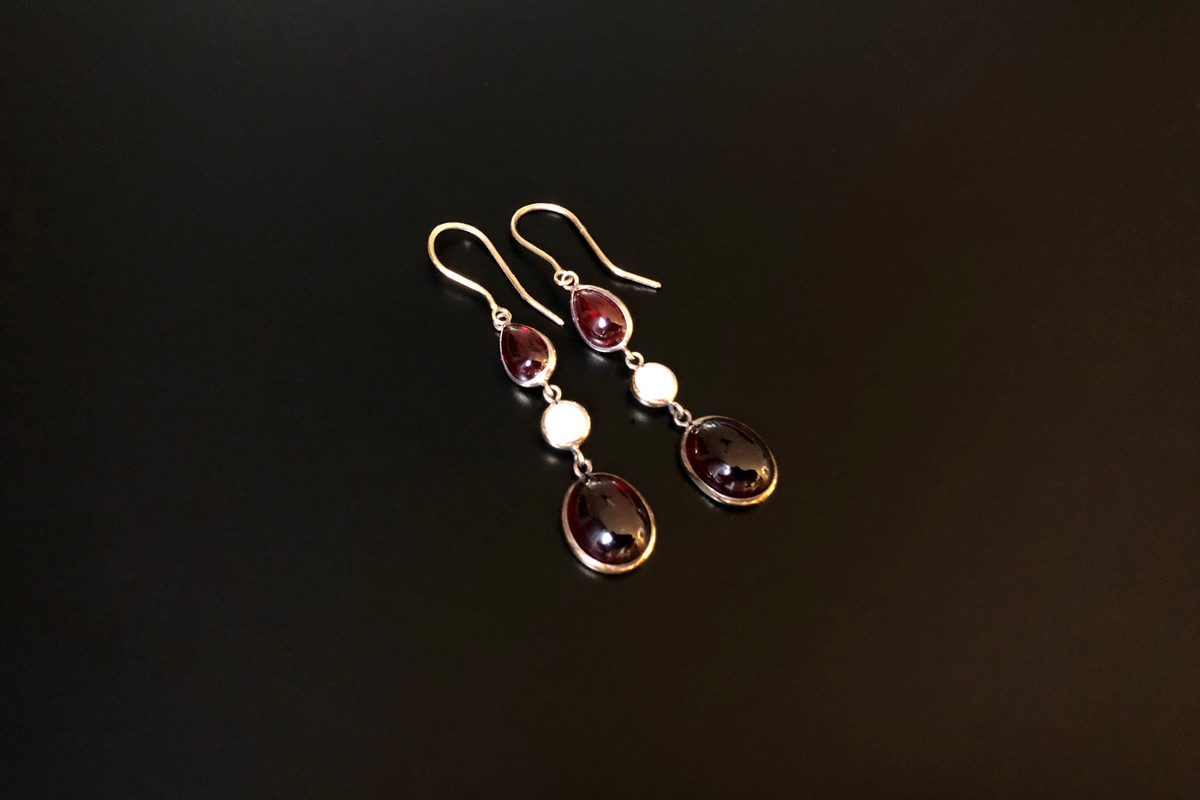 A Lovely Pair of Garnet and Pearl Drop Earrings Each containing a pear shaped and oval cabochon garnet and one half pearl 14ct yellow gold setting Total weight: 3.28gms Total length: 45mm Vintage