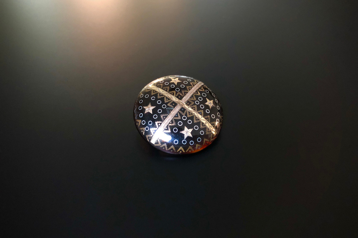 A Piqué Brooch Circular form divided into four sections Inlay with gold and silver decorative motif of stars, geometric and circular forms. Total weight: 5.93gms Victorian