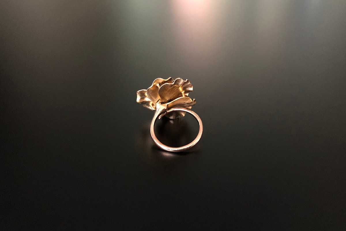 A Divine Gold and Enamel Pansy Ring Reimagined. Set with a central Old Mine Cut diamond Petals in matt black enamel with 10ct yellow gold to the reverse Total diamond weight: 0.31cts Total weight: 7.13gms Circa 1890 American 18ct rose gold