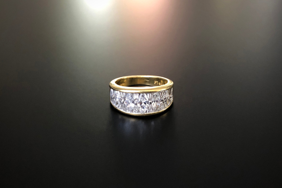 A Fabulous Diamond Band Consisting of seven graduating Marquise Cut diamonds, interspaced with opposing tapered Baguette Cut diamonds, in a channel set design. Pierced inscription to the reverse JB.STAR in Platinum. Approximate Marquise diamond weight: 1.50cts 18ct yellow gold. Total weight: 7.53gms Size: J