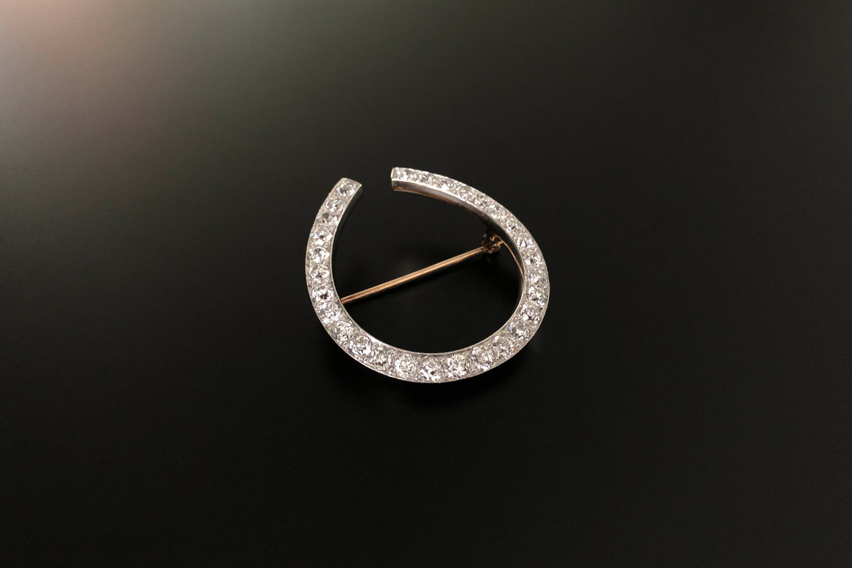 A Marvellous Diamond Horseshoe Brooch Effortless design in the form of a horseshoe, set with twenty nine Old European Cut diamonds,  slightly graduating in size. Approximate diamond weight: 4.00cts Platinum and18ct yellow gold. Total weight: 13.7gms  Dimensions: 40 x 37mm Antique.