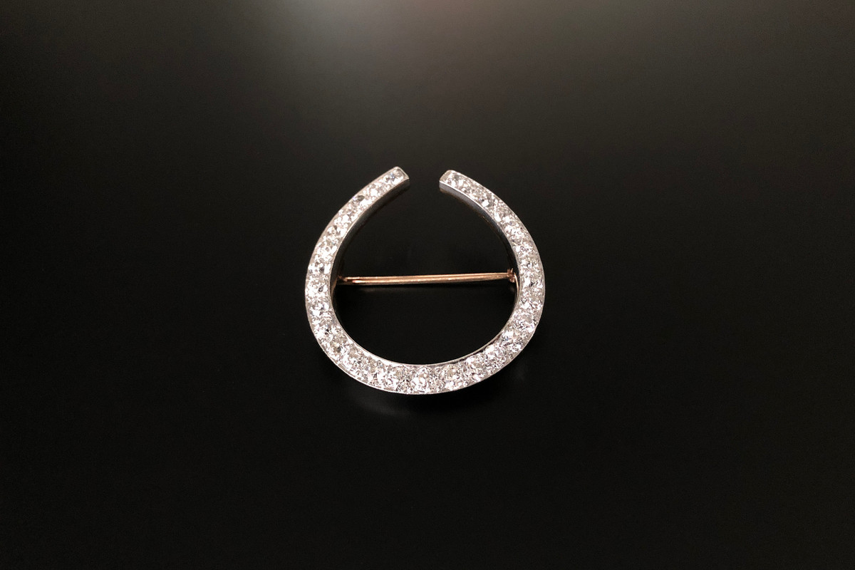 A Marvellous Diamond Horseshoe Brooch Effortless design in the form of a horseshoe, set with twenty nine Old European Cut diamonds,  slightly graduating in size. Approximate diamond weight: 4.00cts Diamond colour: Diamond clarity: Platinum and18ct yellow gold. Total weight: 13.7gms  Dimensions: 40 x 37mm Antique.