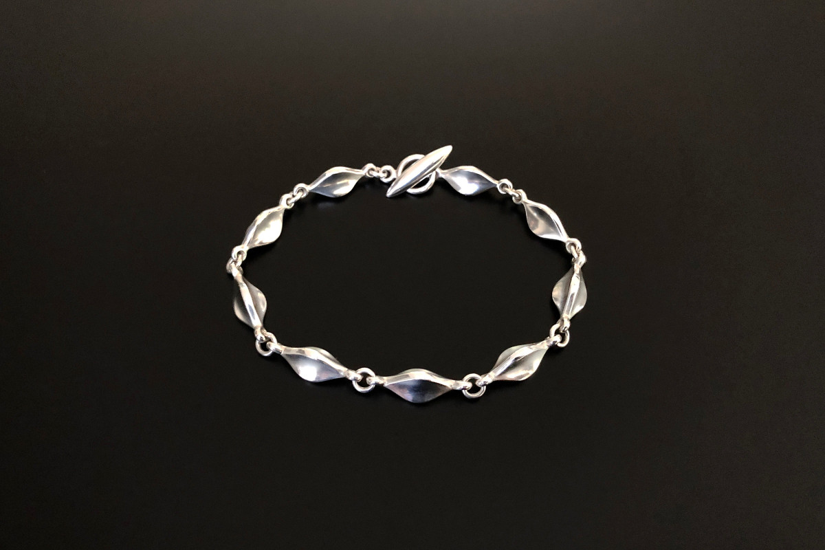 A Stylish Silver Bracelet by Georg Jensen Designed by Flemming Eskildsen  Elongated fluted panels Sterling silver Reference 180 Total length: 185mm Total weight: 17.25gms