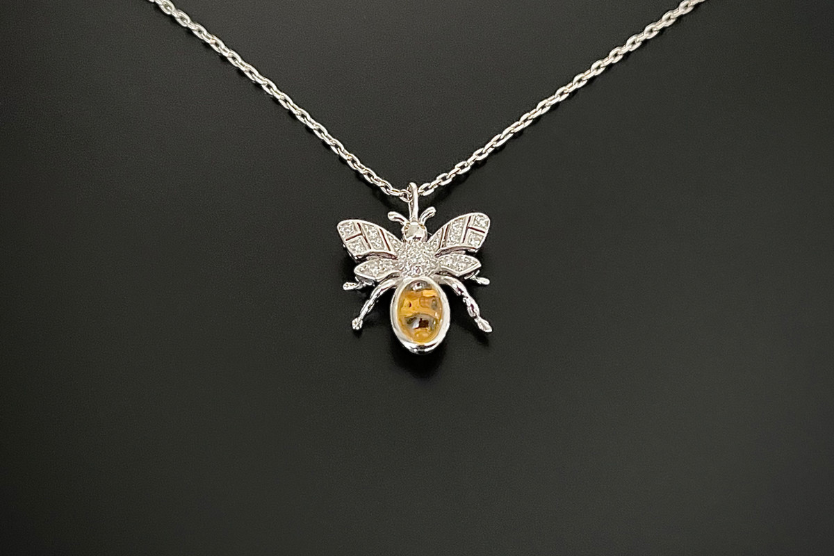 Kozminsky 170th Year Silver Bee Pendant with Citrine. Set with an oval cabochon citrine body with diamond set wings. Two small cabochon citrine for eyes. Citrine weight: 0.91ct Total diamond weight: 0.10cts Sterling silver. Dimension: 15mm x15mm. Sterling silver chain: 50cm