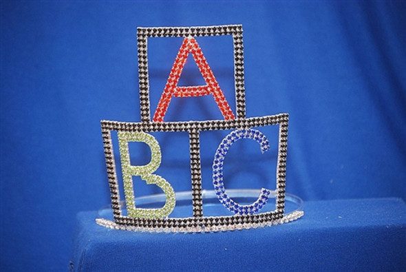 "A ""Premier Crowns"" design. Alphabet blocks tiara with adjustable band. 6"" tall"