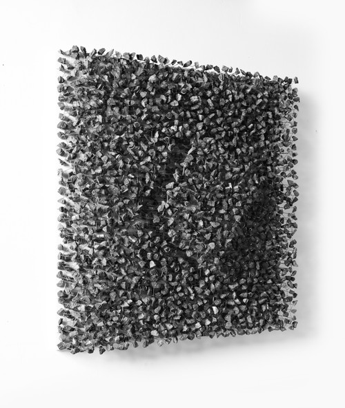 Rise Above 1206 by Ingoo Kang. 2012. Stone, Stainless wire, Birch plywood, Acrylic case. Relief sculpture