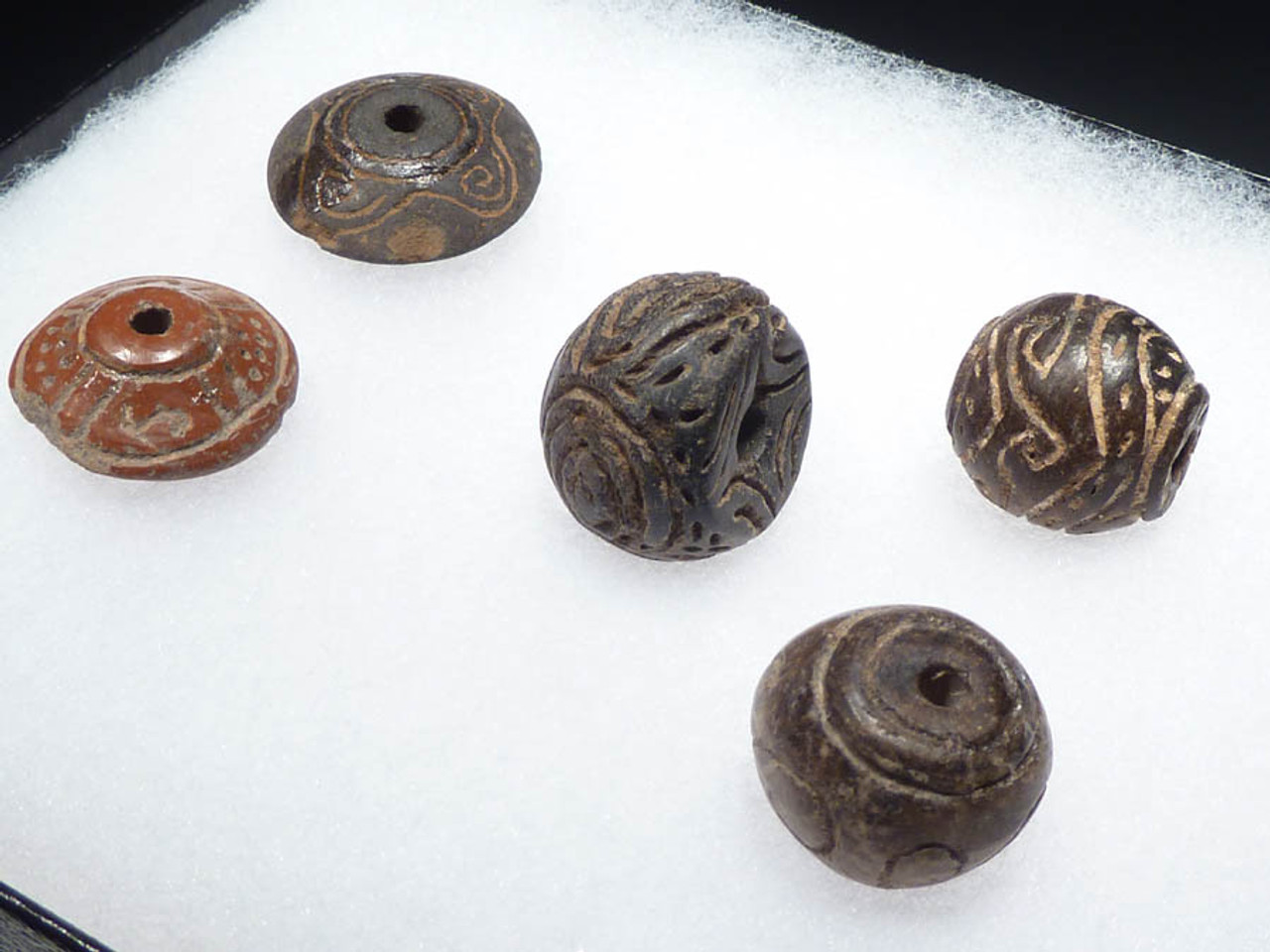 PC042 - FIVE PRE-COLUMBIAN STONE AND CERAMIC LARGE DECORATED BEADS FROM THE ANCIENT CHIMU CULTURE OF SOUTH AMERICA