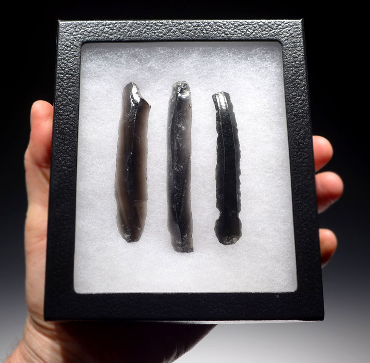 PC223 - SET OF THREE AZTEC PRE-COLUMBIAN COMPLETE UNBROKEN OBSIDIAN PRISMATIC BLADES ONE WITH EVIDENCE OF HAFTING