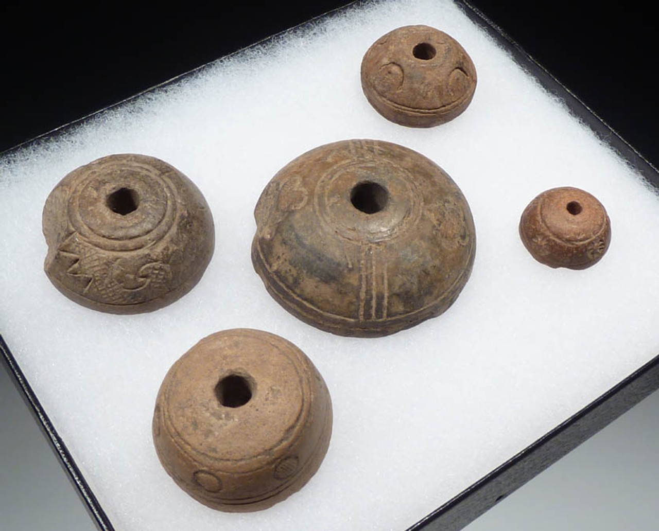 PC044 -  FIVE PRE-COLUMBIAN SPINDLE WHORLS USED IN ANCIENT TEXTILE MANUFACTURE FROM THE ANCIENT CHIMU CULTURE OF SOUTH AMERICA