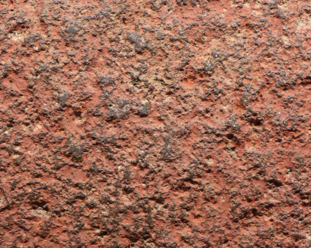 HEAVY RED PIGMENT IS THE ANCIENT ORIGINAL RED OCHRE PIGMENT FROM WHEN THIS LARGE GRINDER WAS USED.