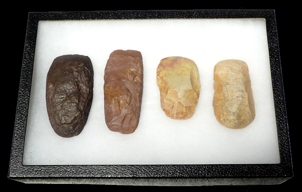 CAP127 - AFRICAN NEOLITHIC SET OF FOUR KNAPPED AND POLISHED CHERT AND QUARTZITE STONE BATTLE AXES OF VARIOUS DESIGN