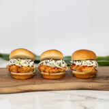 Trio of deliciously irresistible chicken sliders in between King's Hawaiian Original Hawaiian Sweet Slider Buns (Pre Sliced) 9ct and dressed with King's Hawaiian Big Island Lava BBQ Sauce 14.3oz