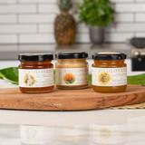 Trio of irresistible organic Ohia-Lehua Blossom Honey 4.5oz, organic Wilelaiki Blossom Honey 4.5oz, and Macadamia Nut Blossom Honey 4.5oz